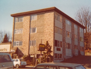 My apartment building in Seattle across the street from Electricraft Stereo Centers, Inc. (1978) by Mark D. Jones