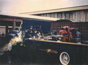 Mark (l) and Bruce (r) on a flatbed truck along the Gulf Coast in the rain (Dec 1976) (Damaged Photo) - Mark D. Jones